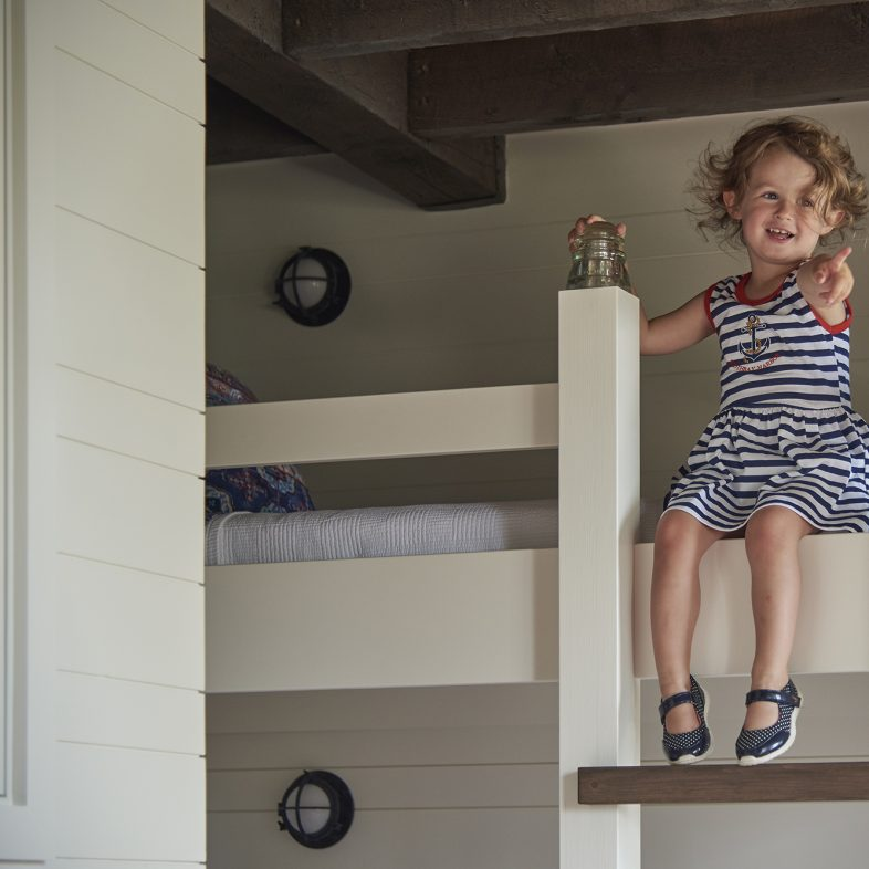 Child enjoying the new bunk beds at the bunkhouse at Basque in the Sun