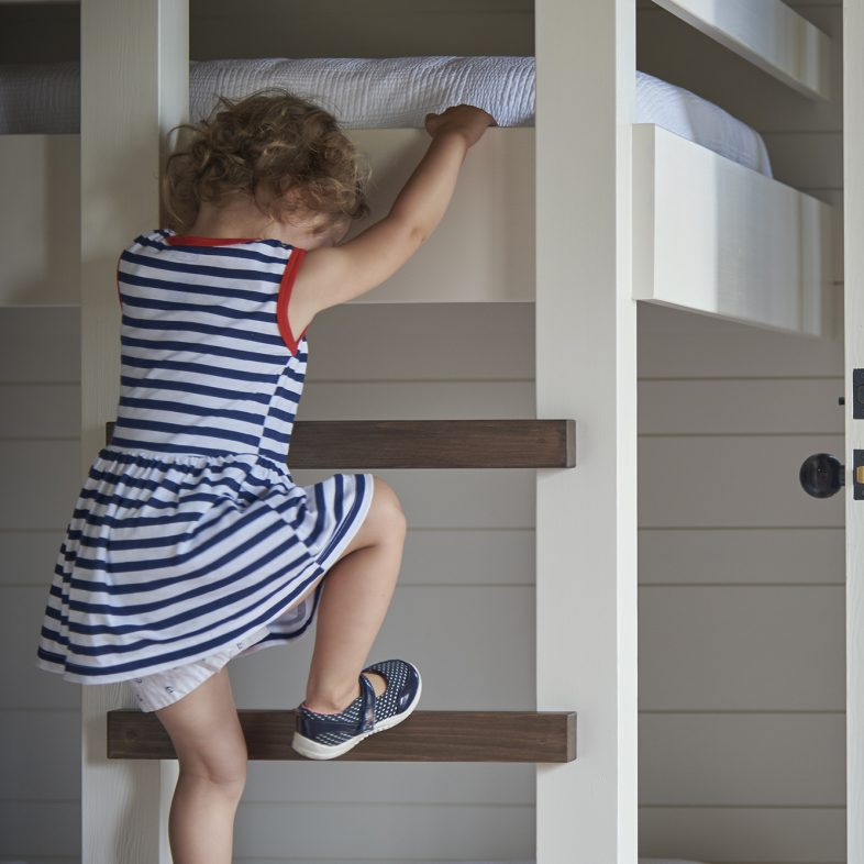 Child testing out the new bunk beds at the bunkhouse at Basque in the Sun