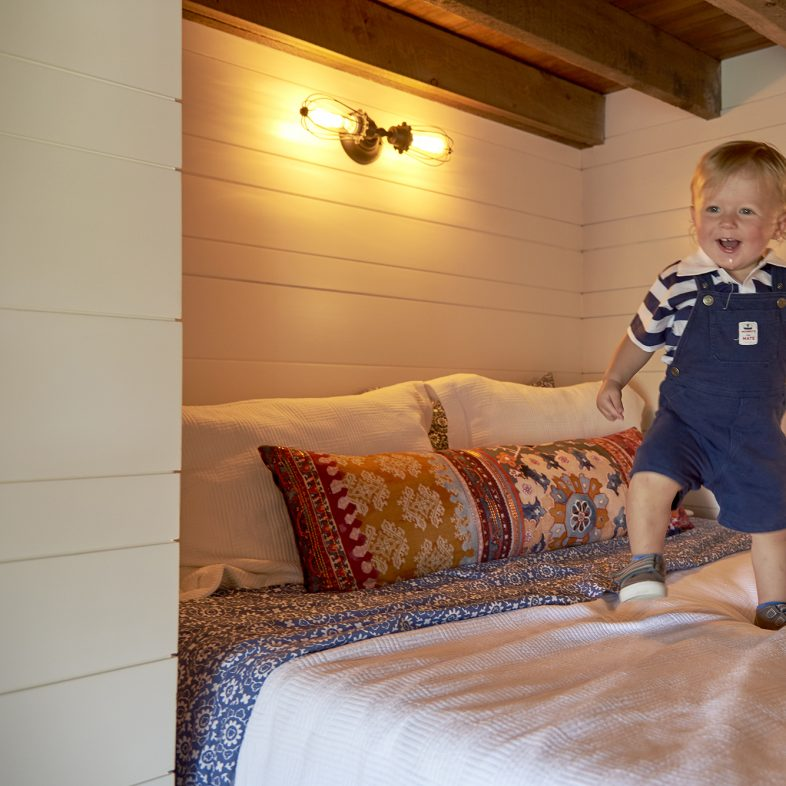 Child enjoying the new cottage bedroom at Basque in the Sun