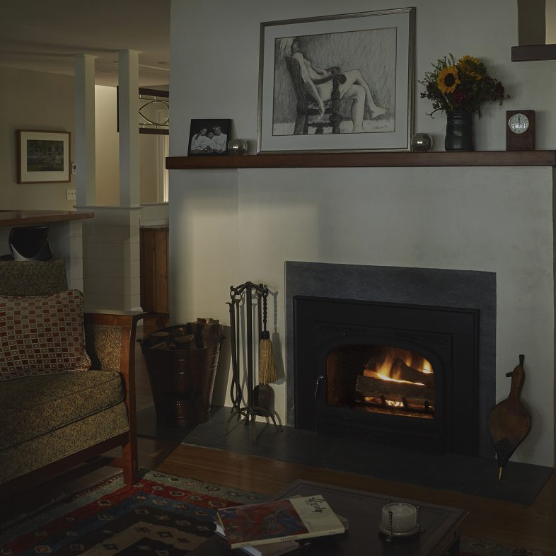 Simple fireplace in the living space at Broad Cove