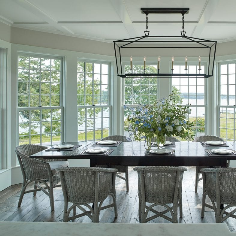 Large dining area with farmhouse style lighting, and 180 degrees of unobstructed coastal Maine views.