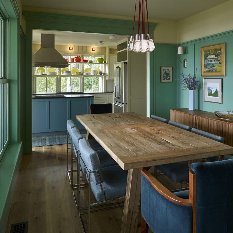 Formal dining room with teal wainscoting at Capitol Island