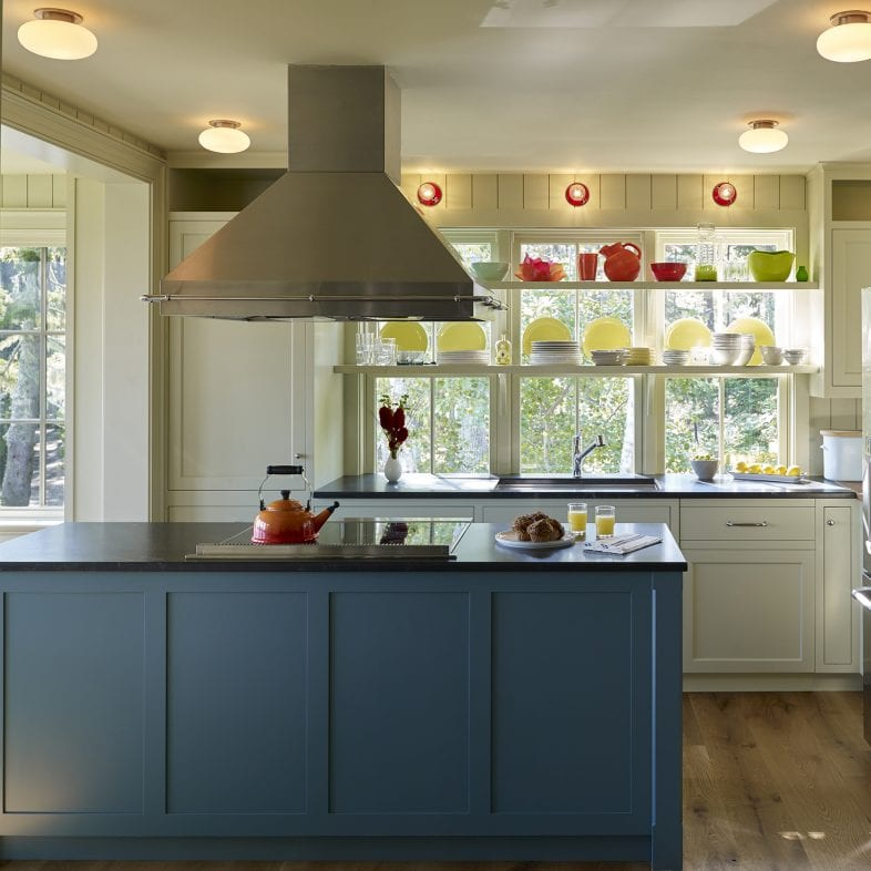 Bright kitchen with dark island and silver hood at Capitol Island