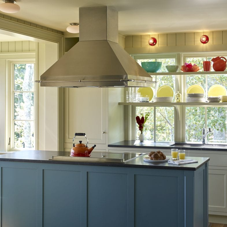 Bright kitchen with oversink exposed shelving at Capitol Island
