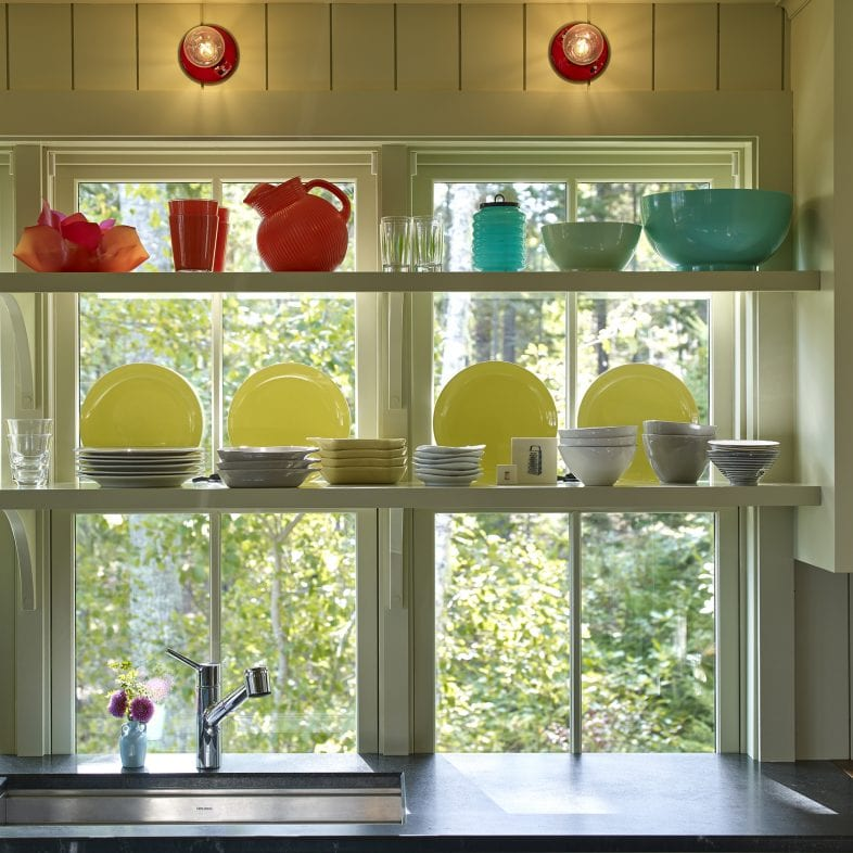 Window shelving with colorful dishes at Capitol Island