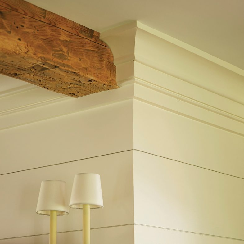 Wooden wall detailing with wooden beam at Chestnut Way