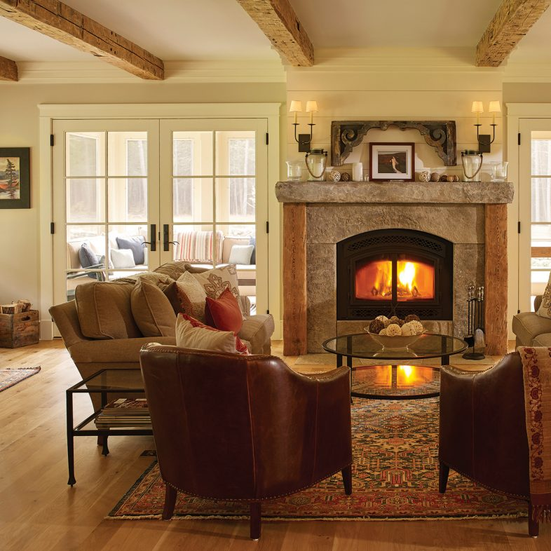 Cozy living area at Chestnut Way with a stone fireplace