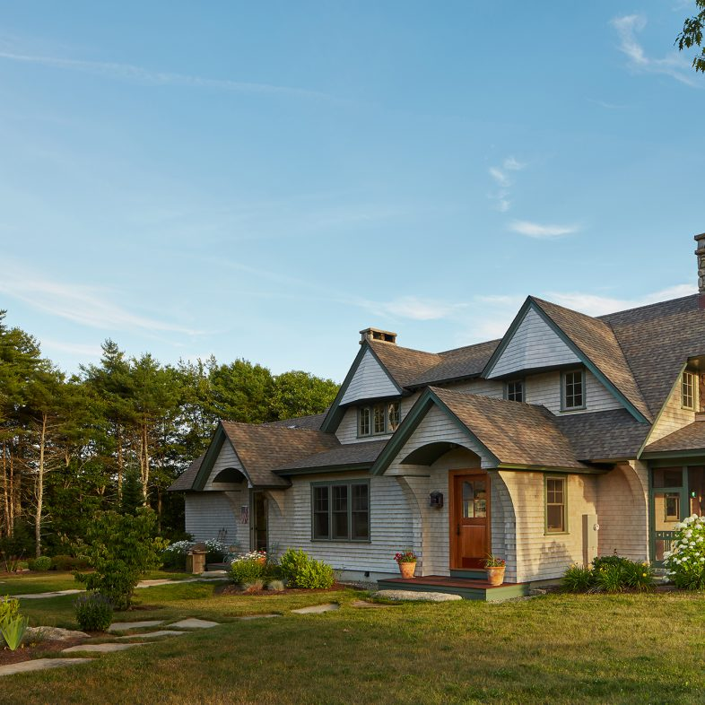 The approach to the cedar shingled cottage-style house