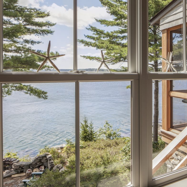 Expansive windows offering panoramic views at the Cross Point Cottages
