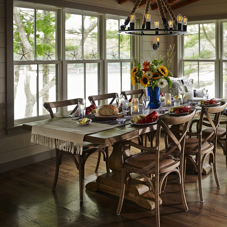 Formal dining room with sweeping water views at the Cross Point Cottages