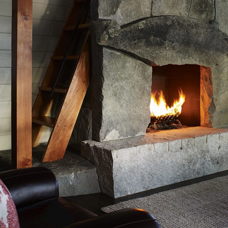 Stone fireplace at the Cross Point Cottages