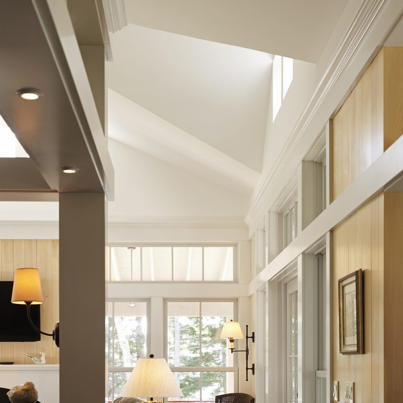 A view of the hallway leading to the double-height ceiling living room.