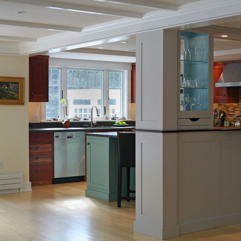 A semi-open kitchen with half-wall divider