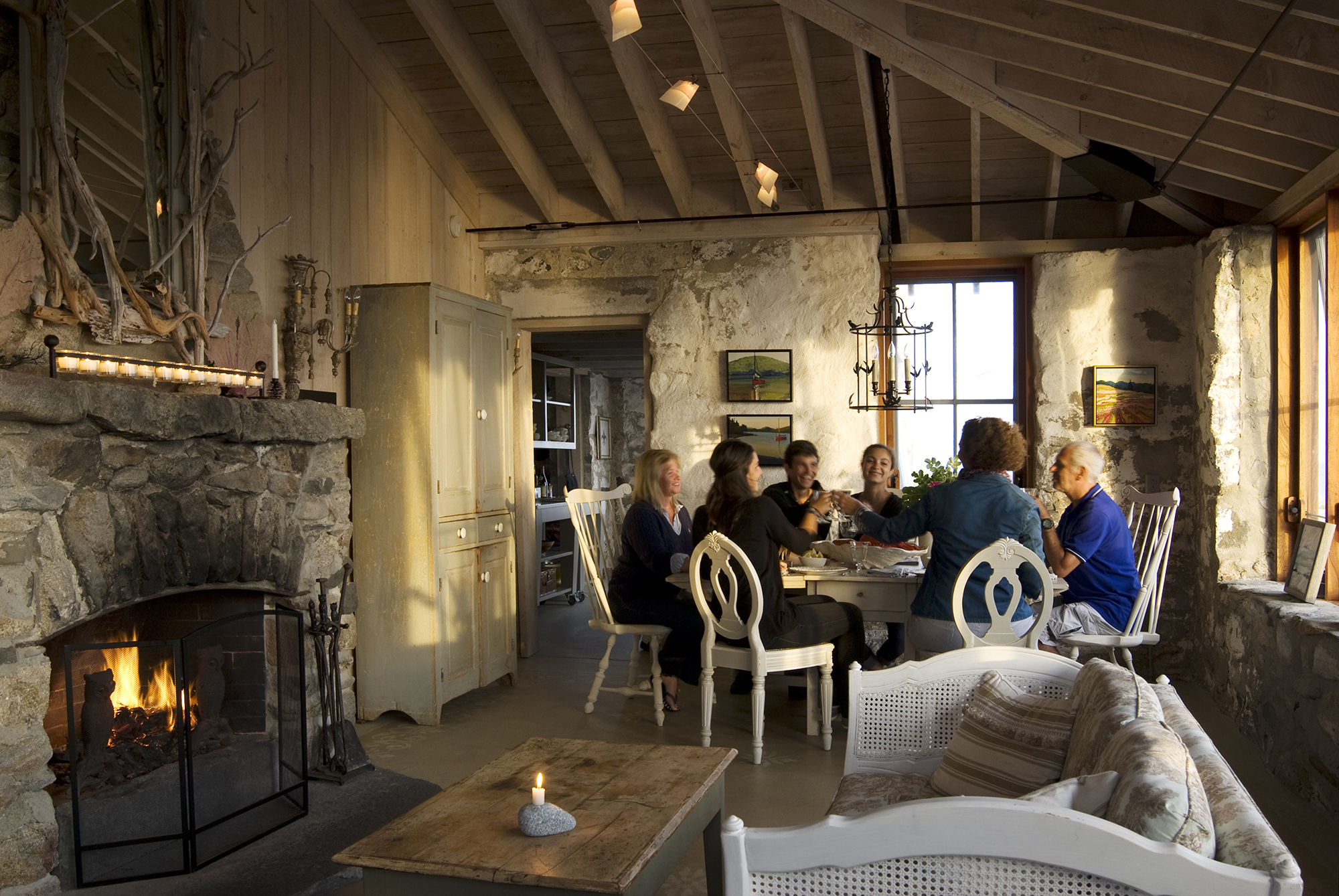 Family enjoying a meal at the dining table at Hunting Island Cottage