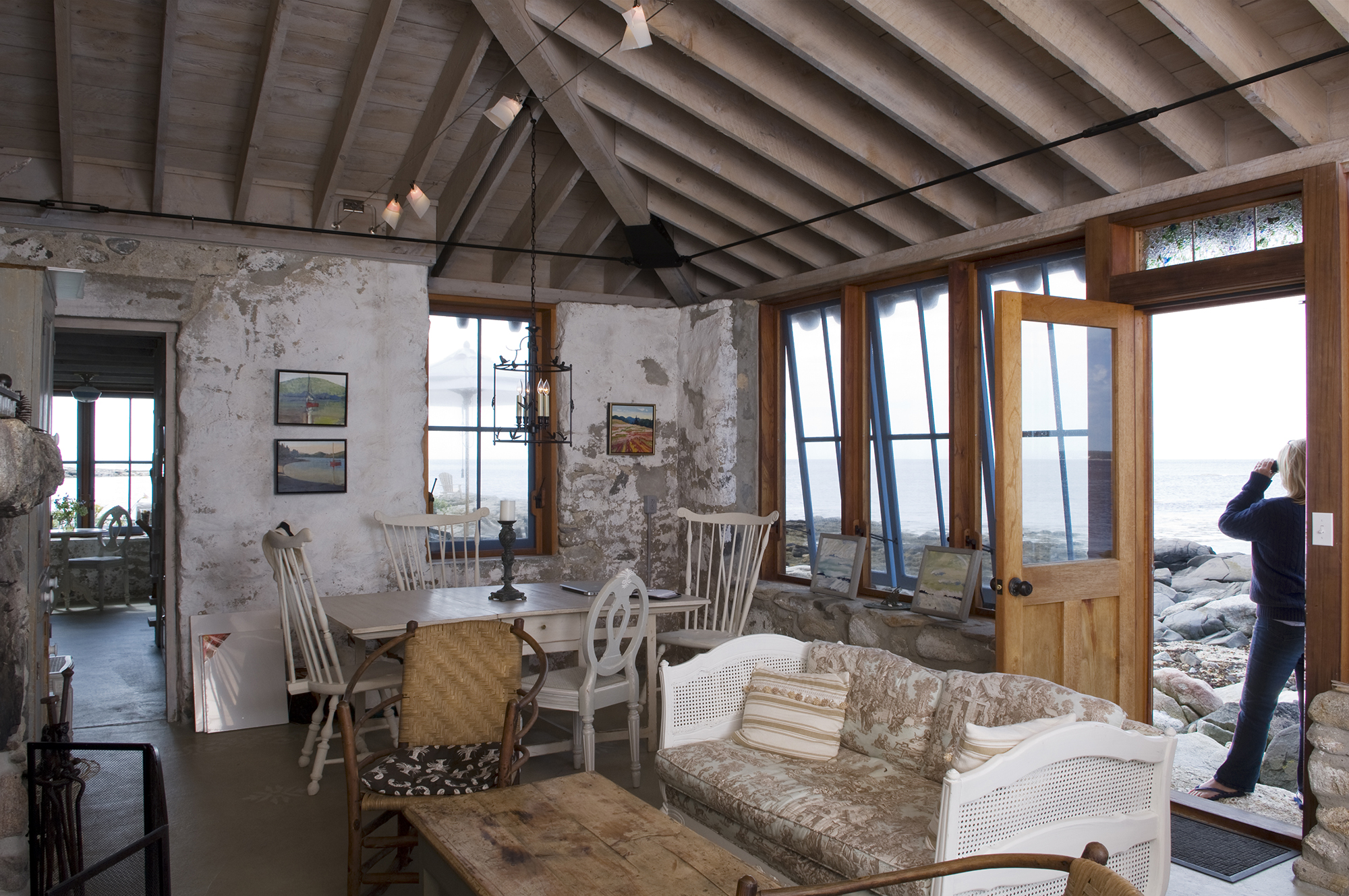Stepping out to the rocks from the living area at Hunting Island Cottage