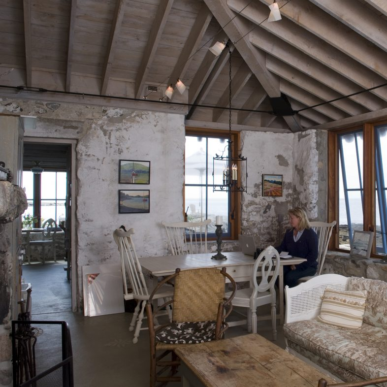 Woman enjoying the dining area at Hunting Island Cottage