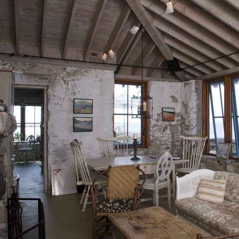Light filled living and dining area with 360 degree water views at Hunting Island Cottage