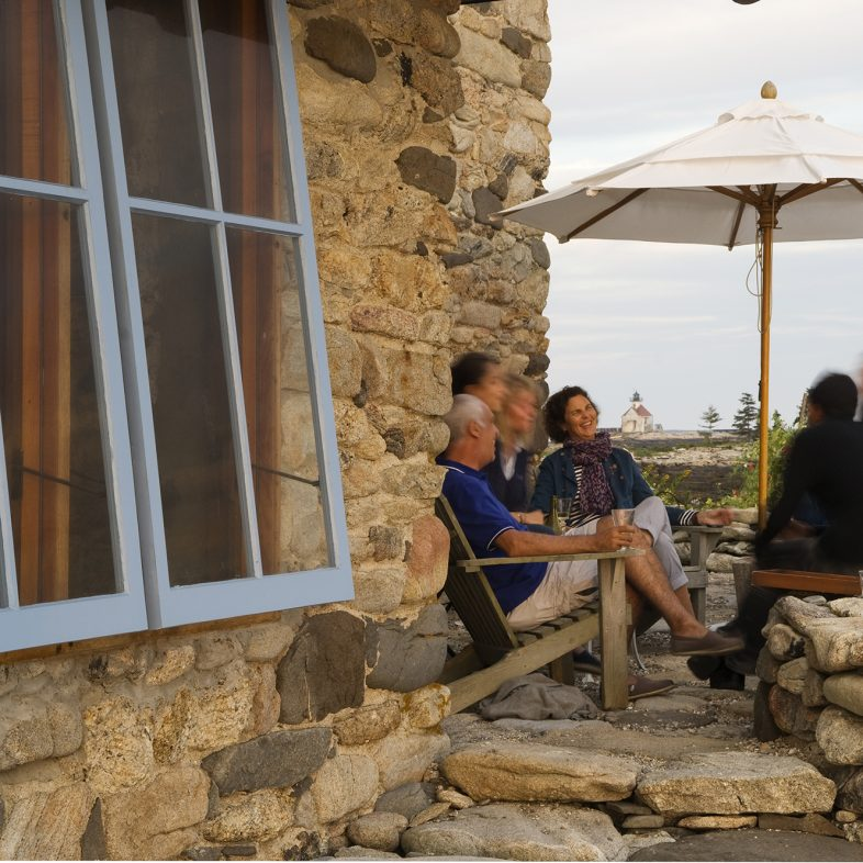 Friends enjoying the stone patio at Hunting Island Cottage