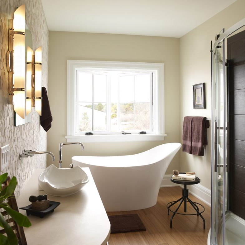 Relaxing bathroom with hardwood floors at Beach Cliff