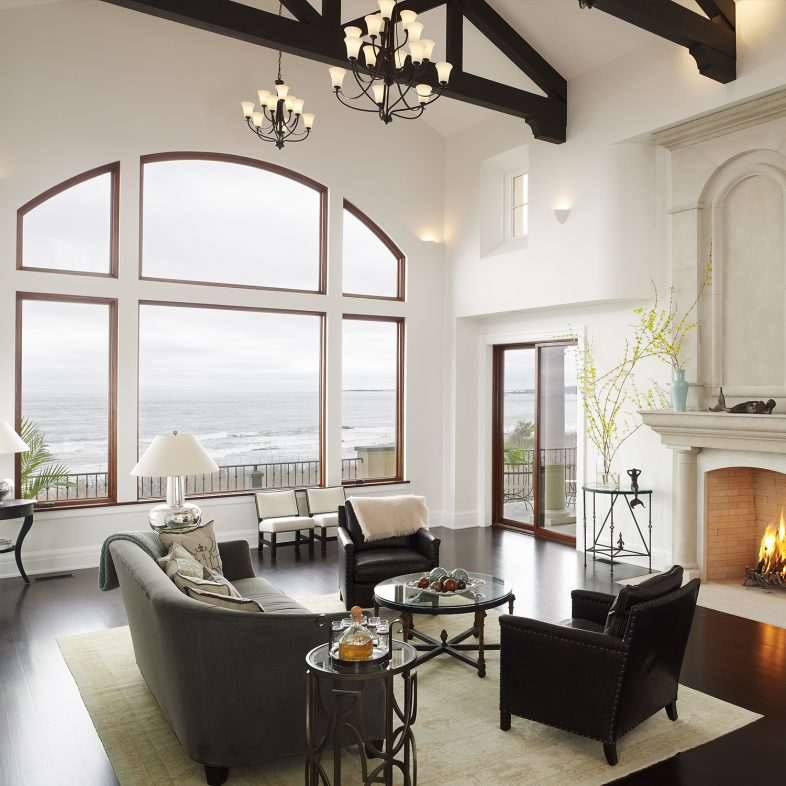Double height living space at Beach Cliff with coastal views