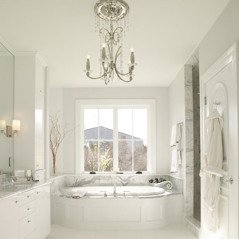 Light and airy bathroom with mosaic tile detailing in the bathroom at Beach Cliff