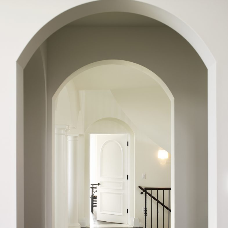 Elegant archways in the hall of Beach Cliff