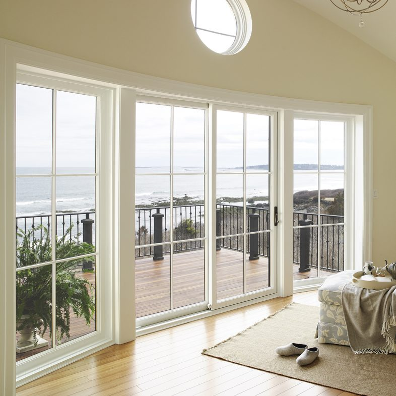 Large window with coastal views at Beach Cliff