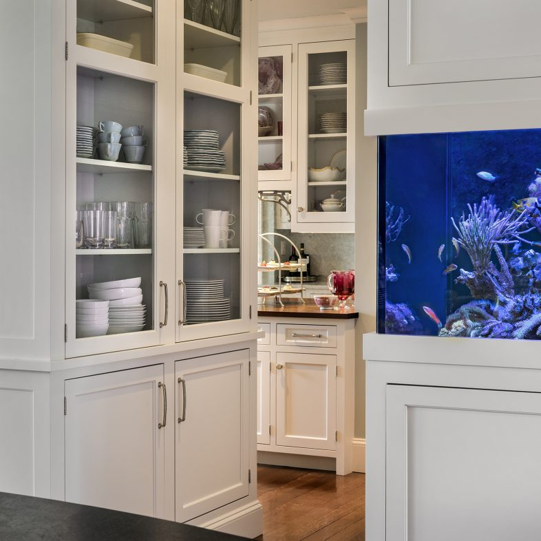 View of the pantry space, built ins, and unique aquarium at Foreside Kitchen