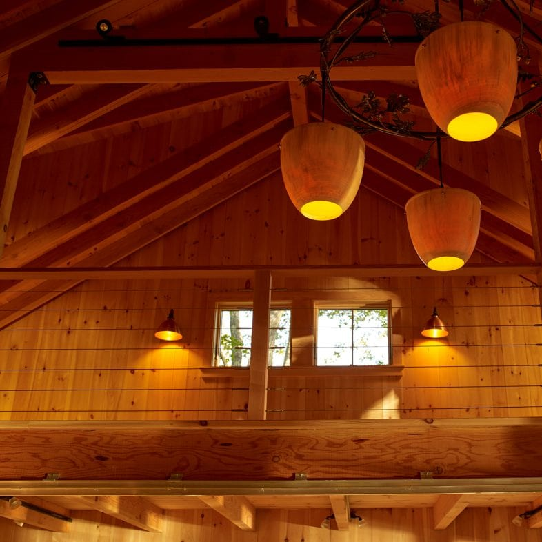 View of the loft with oak-inspired chandelier at Little Acorn Cottage