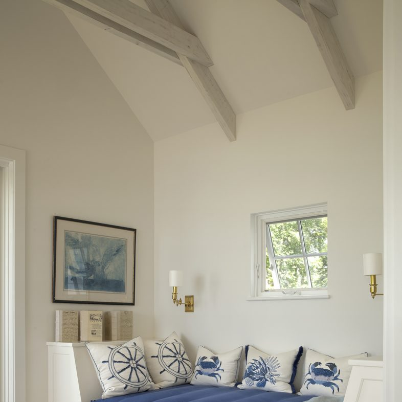 Nautical themed room with built-in day bed and blue hues