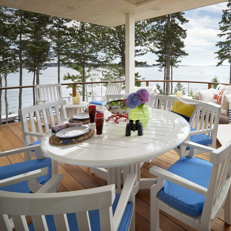 Covered deck with plenty of sitting space and coastal views