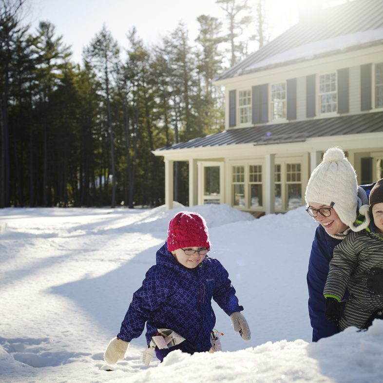Children enjoying the large front yard in the winter at Chestnut Way