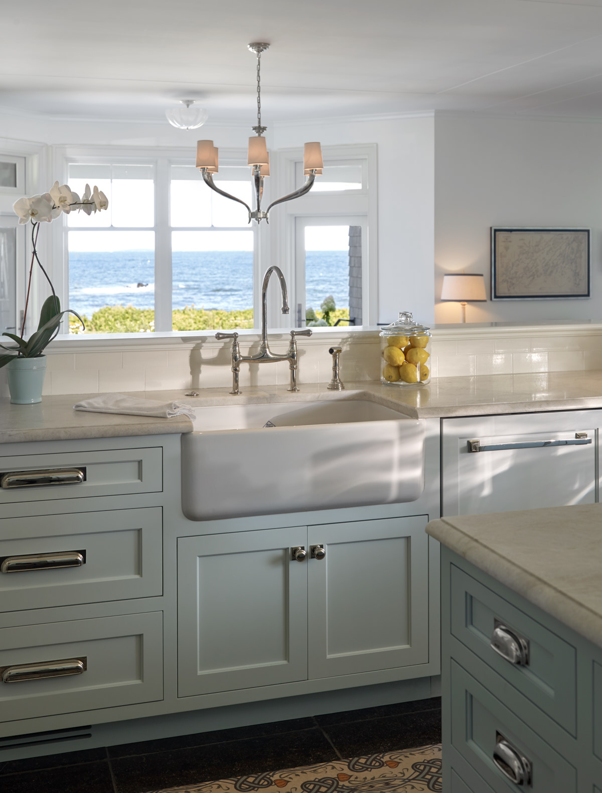 Bright kitchen with unique light fixture and silver accents.