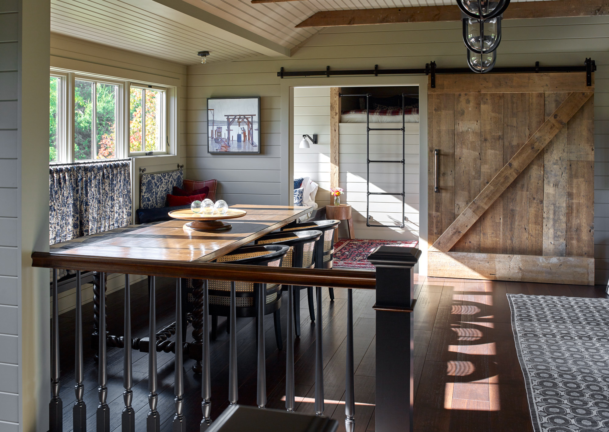 Kitchen area with rustic design and sliding barn door