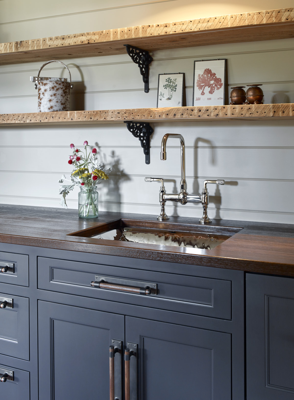 Rustic sink with hammer finish and dark stained wood countertops