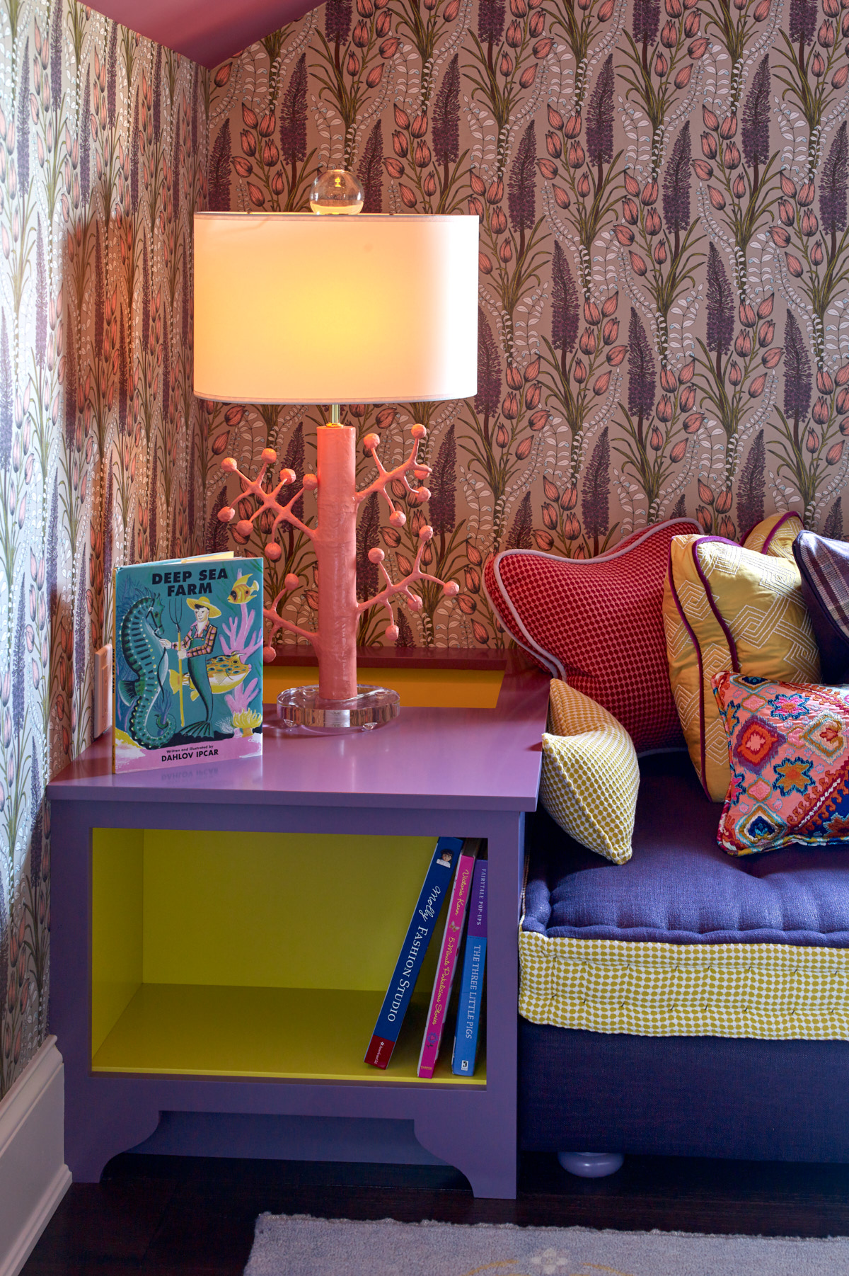 This reading nook sparks imagination with unique wallpaper and coral-inspired light fixture.