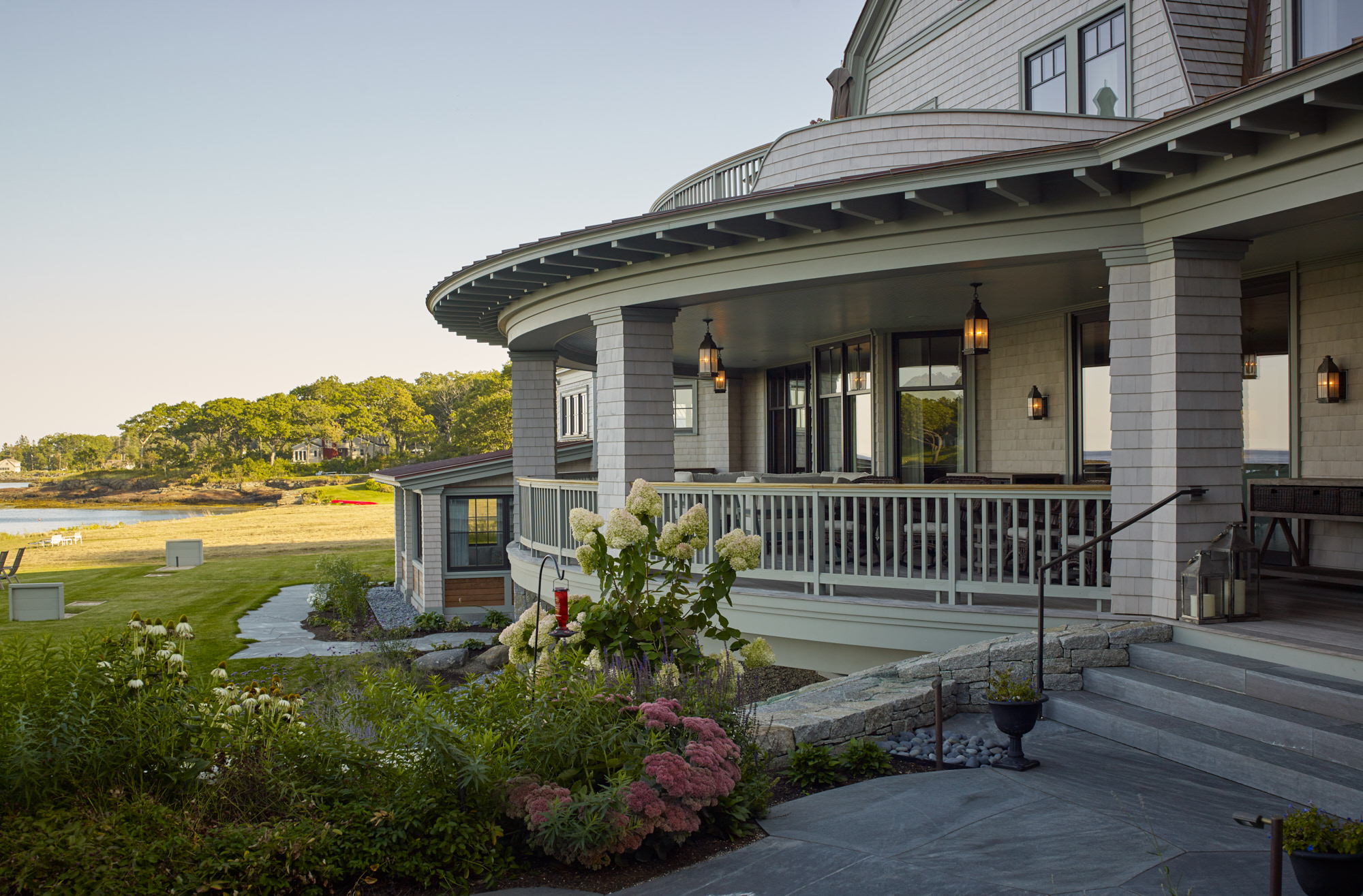 Curved deck overlooking the ocean in Maine at Salacia.