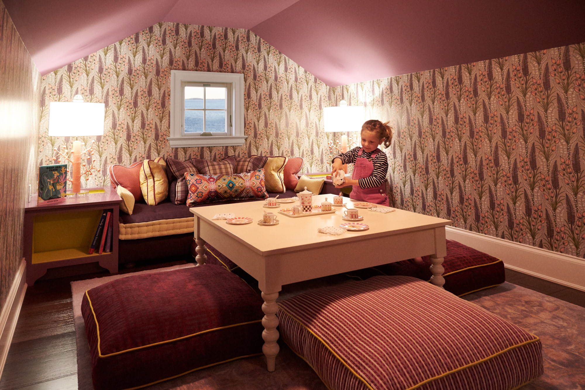 A fun and cozy tea party room with unique wallpaper and patterns.