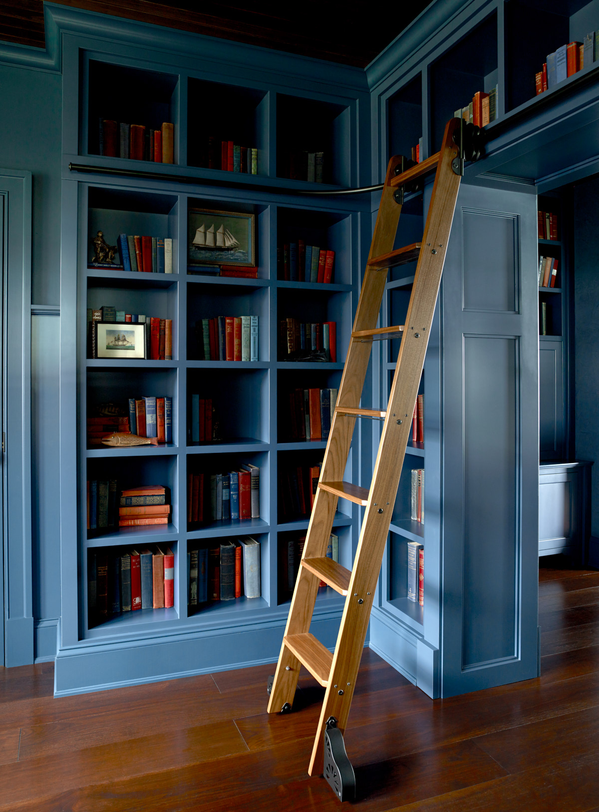 A view of the library at Salacia, complete with a ladder to reach the top shelf.