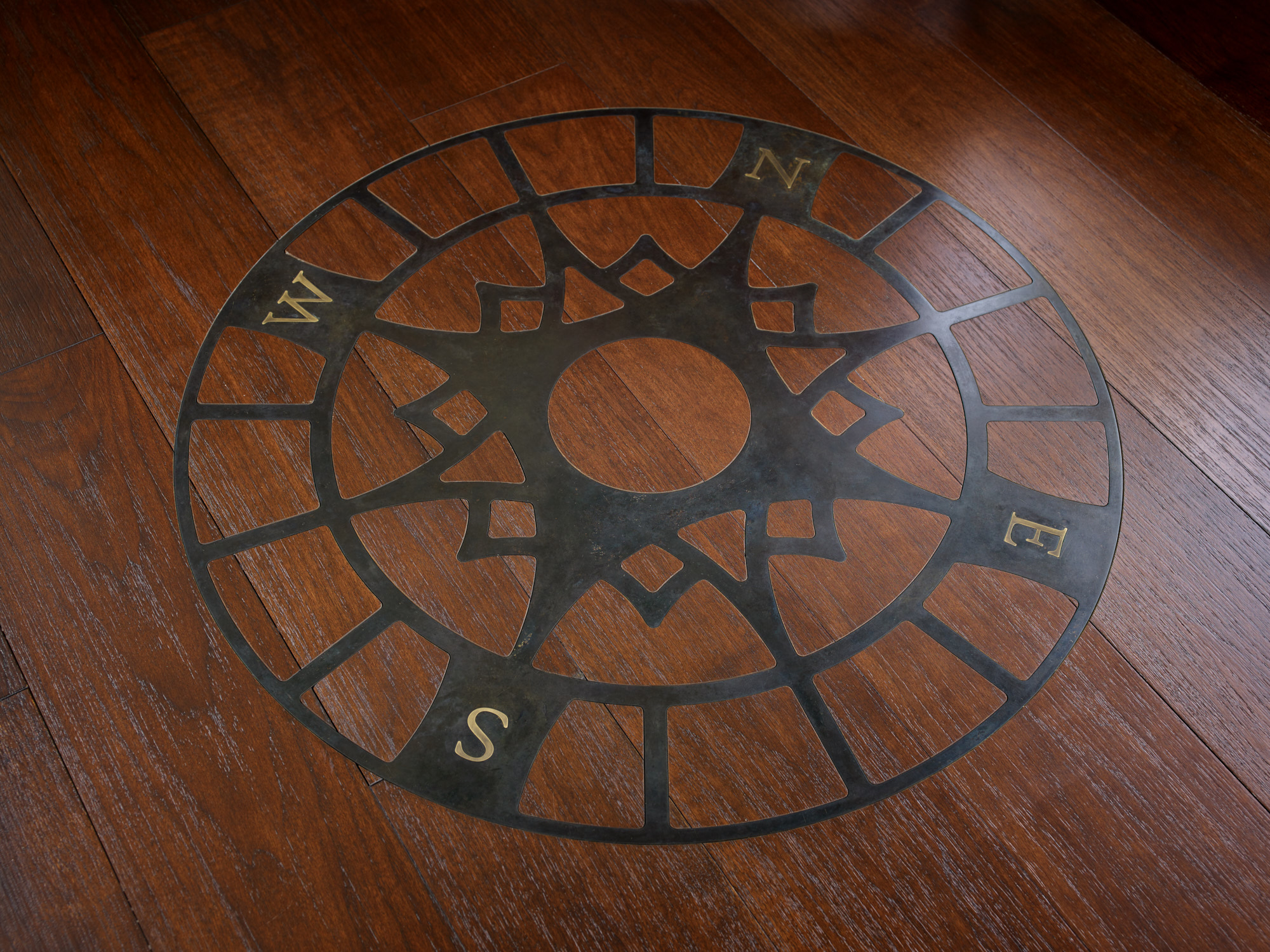 Nautical compass detail on the floor in the lookout room.