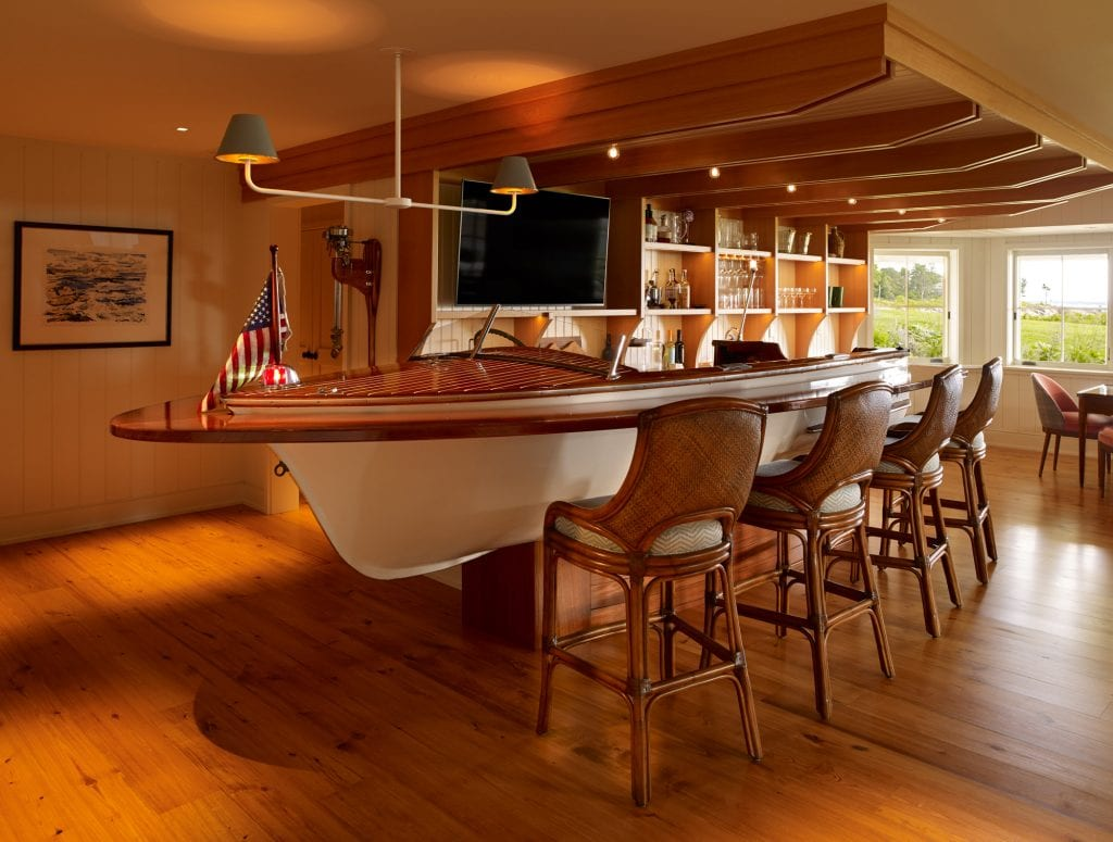The nautical bar that features a boat as the bar and detailing on the ceiling.