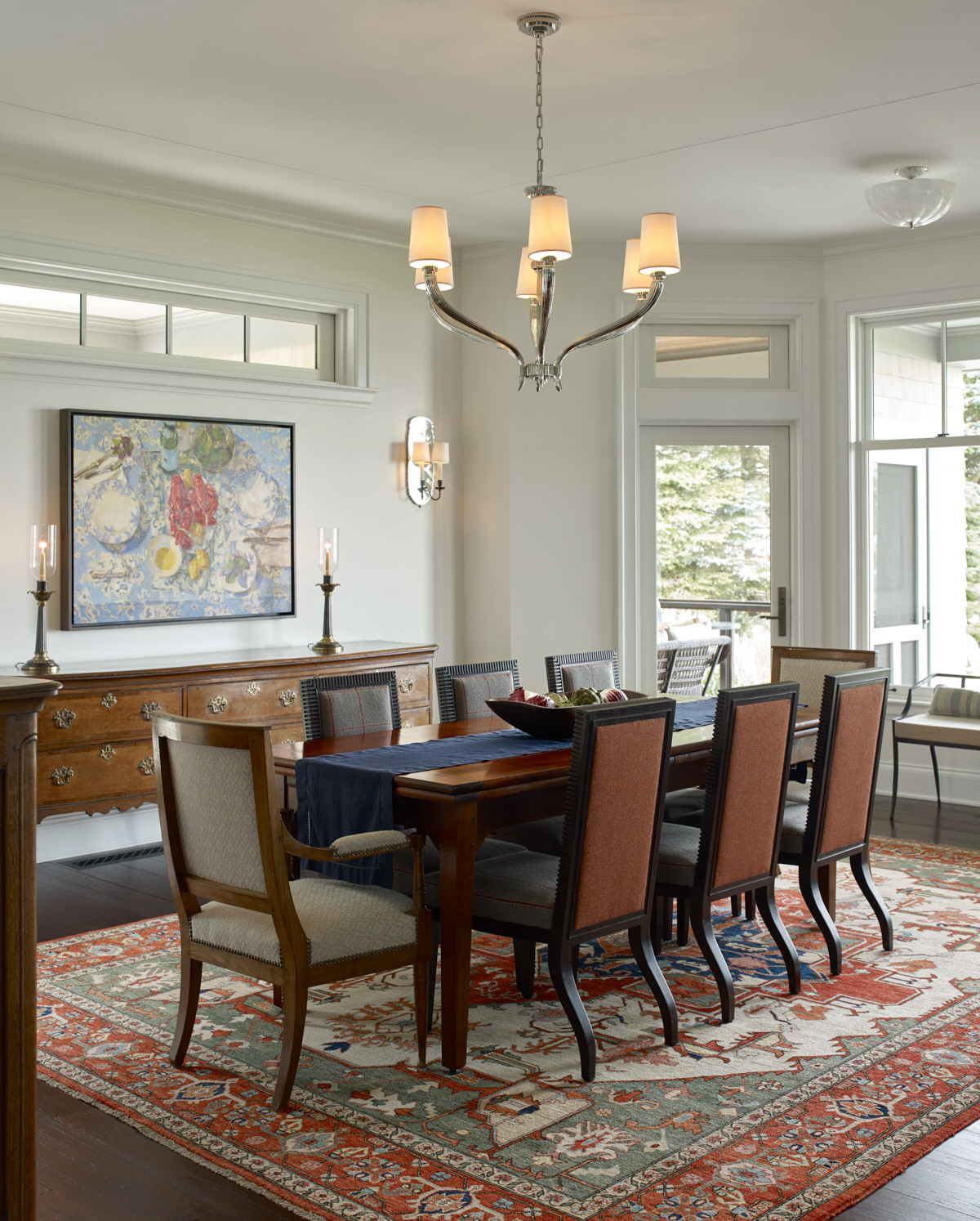 Formal dining area with natural light and unique lighting.