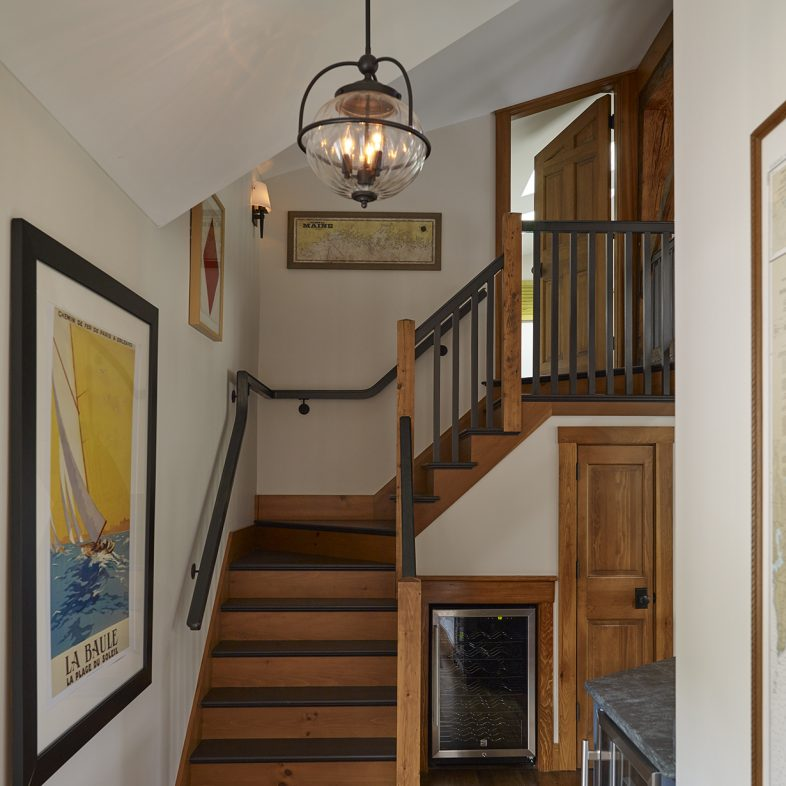 Wooden stair with black accents at the Boothbay Farmhouse
