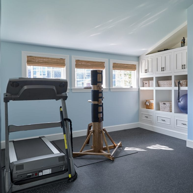 At home gym with storage and natural light