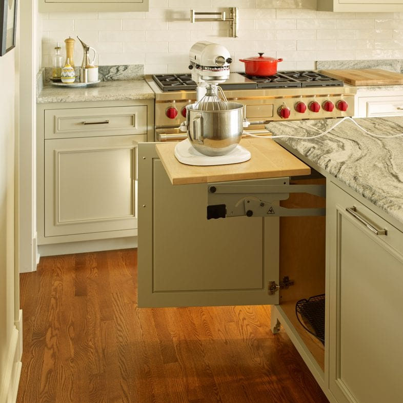 This marbled island features a pop-up station for the KitchenAid standing mixer and pop-up electrical outlet.