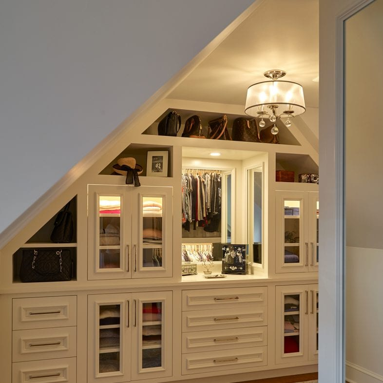 Walk-in closet with large mirror and plenty of storage.