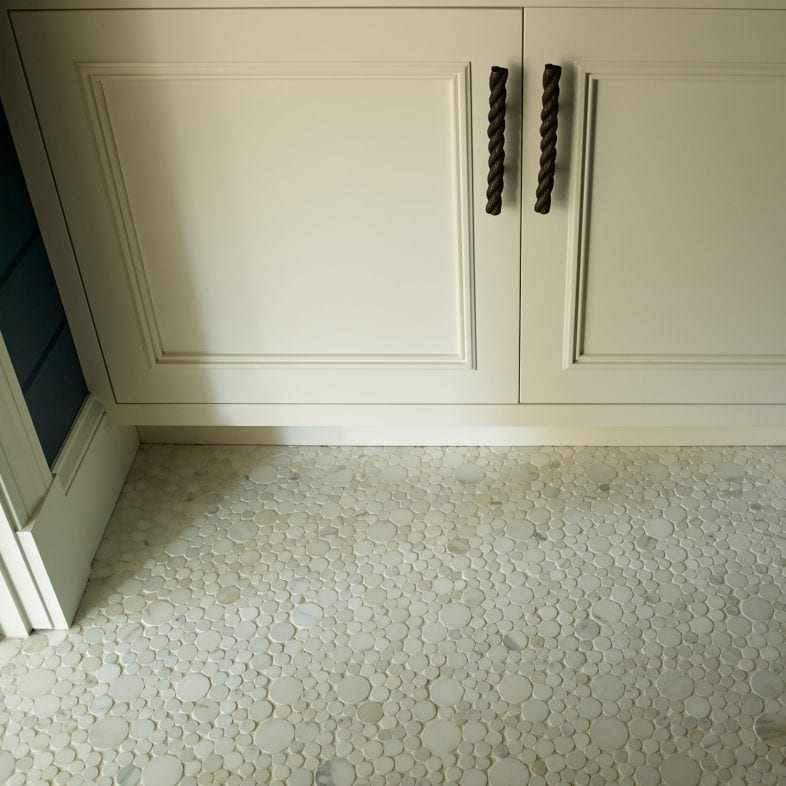 A close-up of the unique tile flooring and twist rope style handles.
