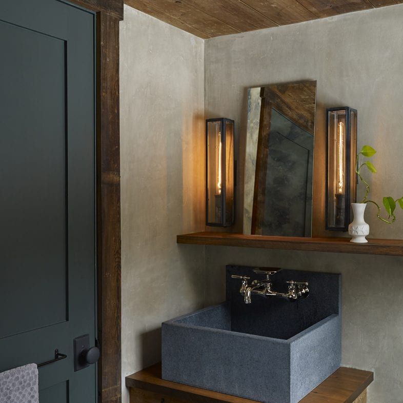 Minimalist rustic bathroom sink and vanity.