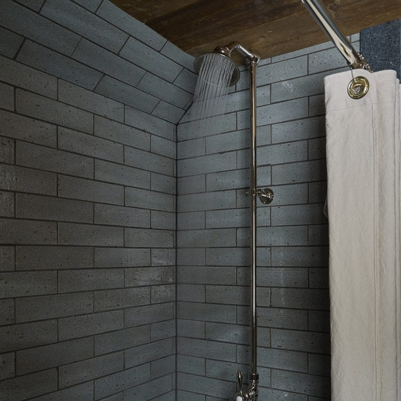Rain shower with vintage handles and exposed pipes