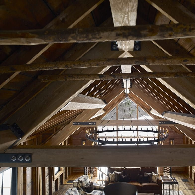 The real raw wood adds to the rustic feel with the exposed beams and large chandelier